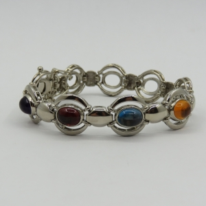Costume jewellery unused silver look alike bracelet with colored stones